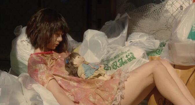 Air doll in garbage dump